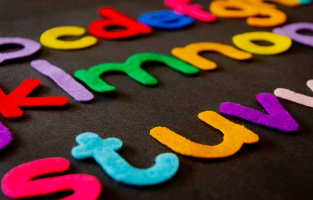 Felt letters attached to a board in alphabetical order.
