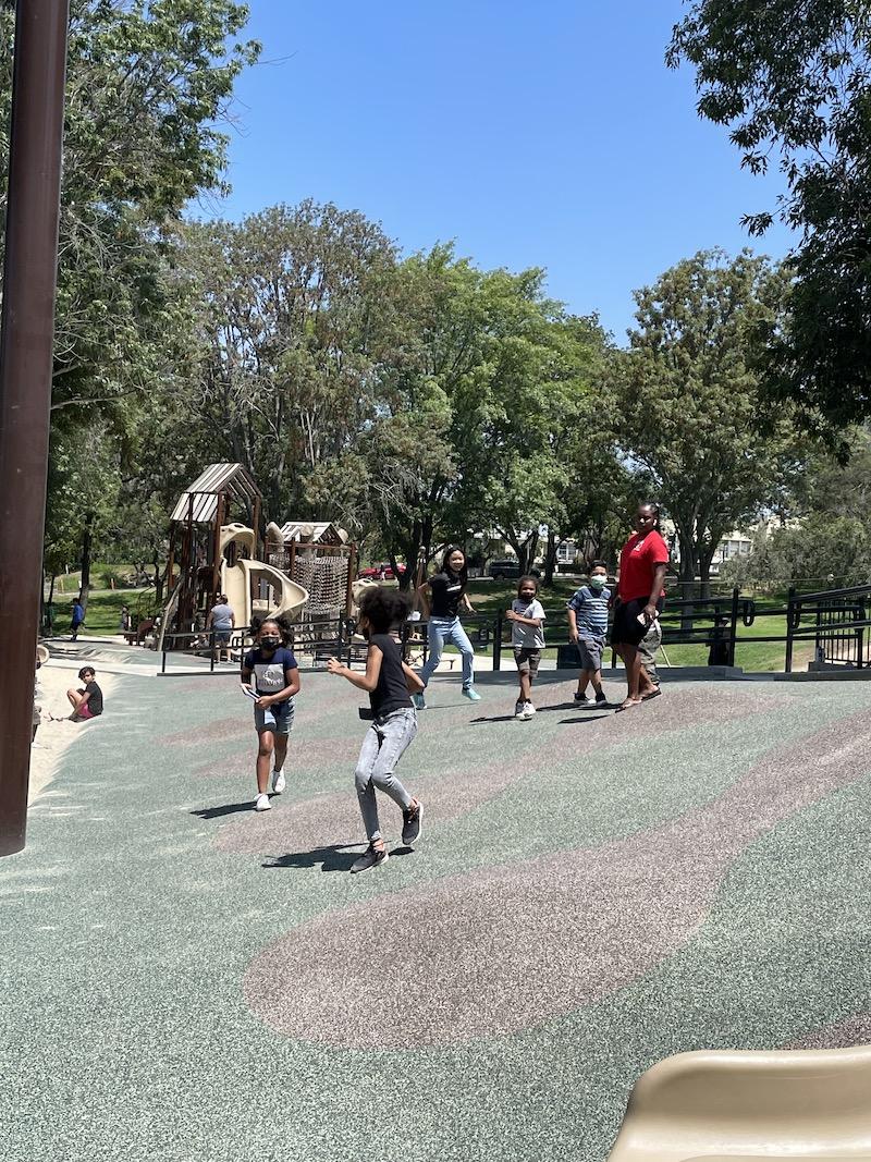 Kids are running around at the playground.