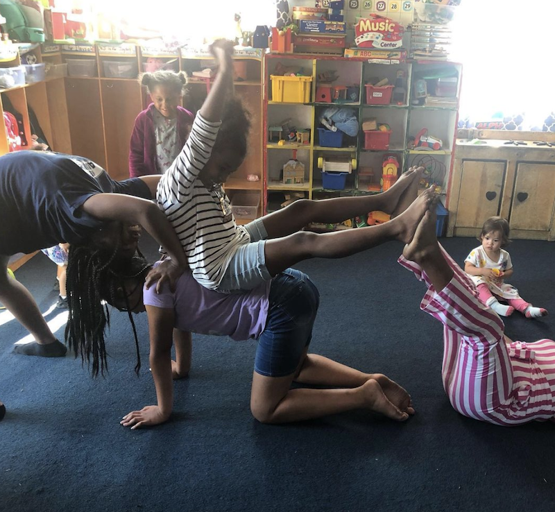 Girls are playing gymnastics in the playroom at The Learning Box.