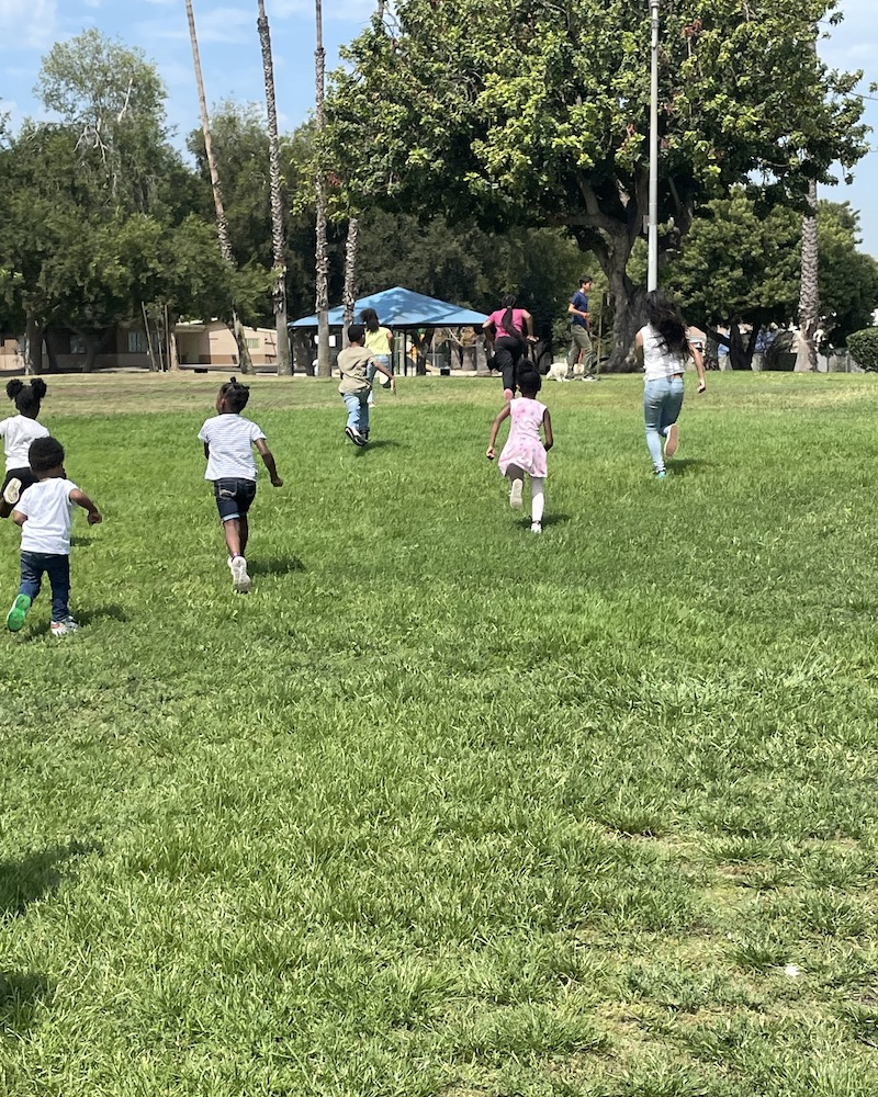 Children are running through the park during playtime.