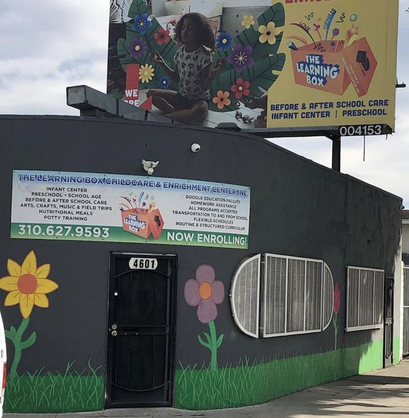 Photo of The learning box building with colorful flowers and artwork painted on the side.